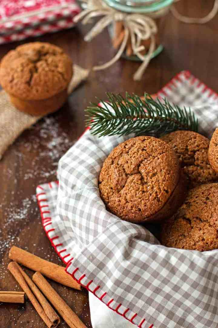 frontal view of basket filled with gingerbread muffins on wooden tabletop