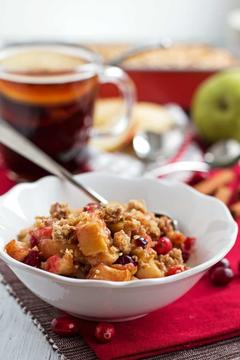 This healthy Skinny Holiday Fruit Crisp recipe makes for an awesome festive treat for your family! A simple filling with apples, pears and cranberries topped off with a delicious oat crunch! Less sugar and butter than you'd find in ordinary recipes!