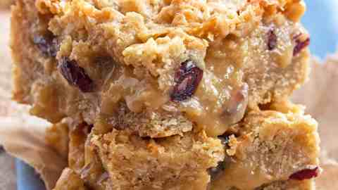 close up view of two stacked gooey oatmeal bars