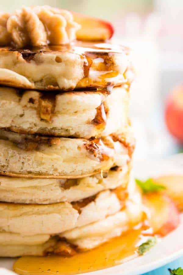 close up photo of stack of peach pancakes