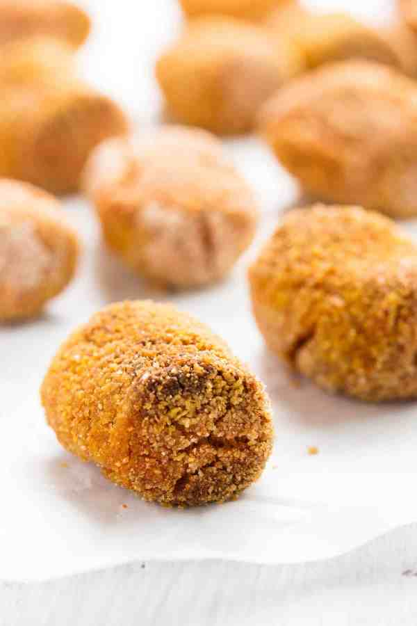This Homemade Pumpkin Tots recipe is the ultimate fall makeover of the potato version! Super easy to make with just one can of pumpkin and a few pantry staples.   savorynothings.com