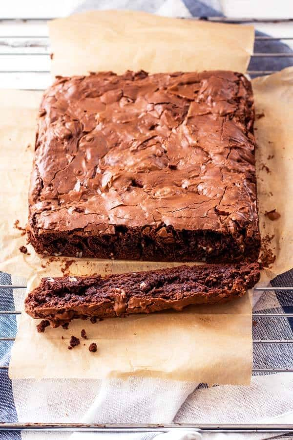 slab of baked brownies before cutting