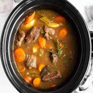 close up photo of crock with Irish beef stew inside