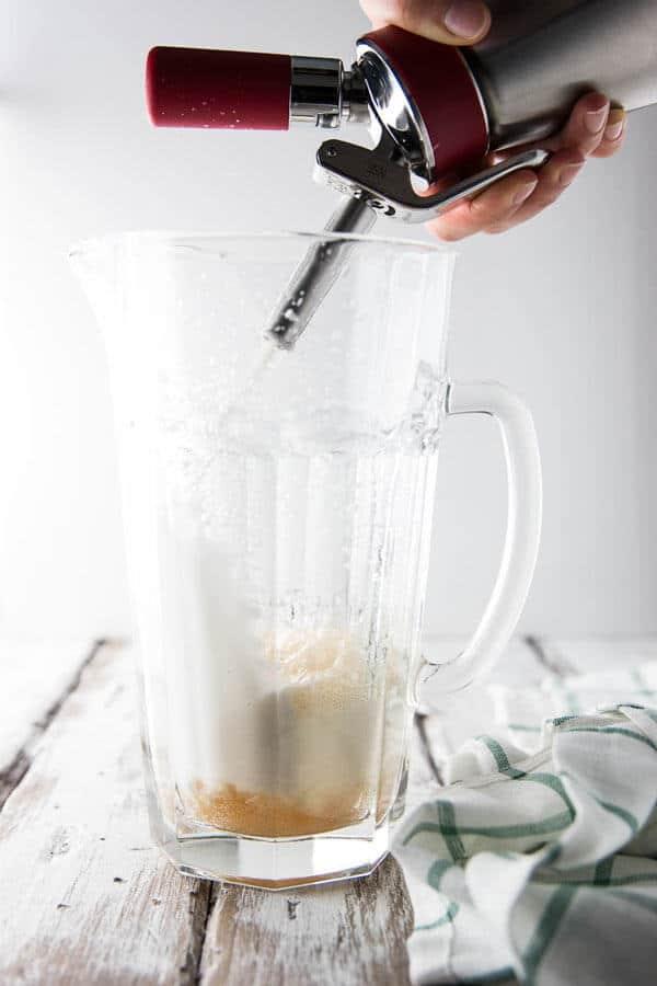 Dispensing spiced ginger lemonade from an Isi whip