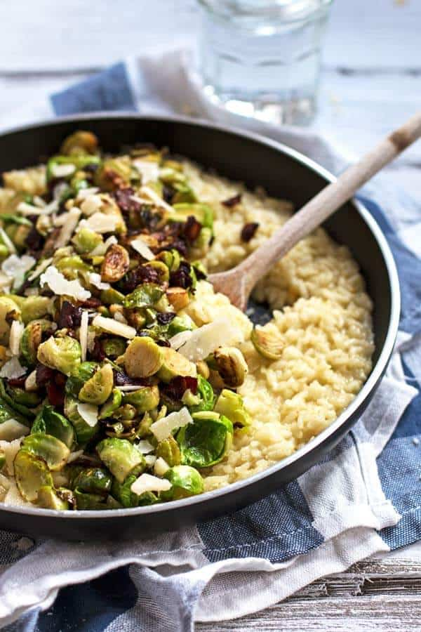 Creamy risotto with bacon and brussels sprouts with parmesan cheese stirred in.