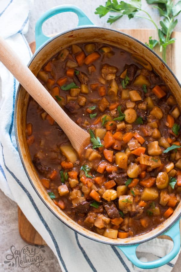 oval dutch oven filled with a classic beef stew