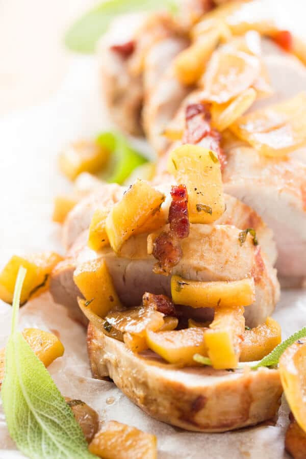 Ever wondered how to cook a decent Sunday dinner for your family without slaving in the kitchen for hours? Try this oven roasted pork tenderloin with apples and bacon! The best option for an easy but impressive meal, and the leftovers taste great for lunch the next day!
