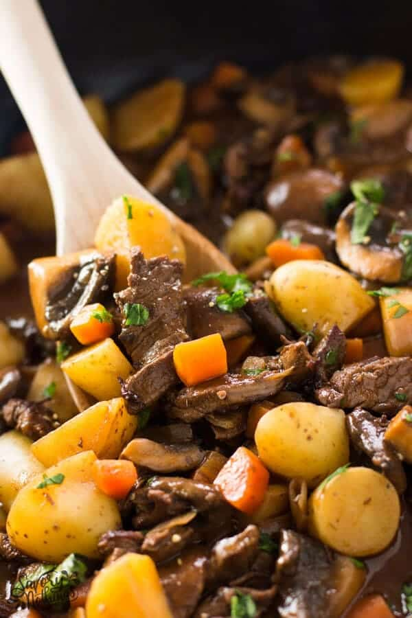 Close up of potato, beef tips and gravy skillet.