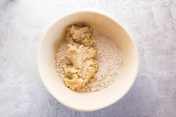 Wet ingredients and dry ingredients for oatmeal cookie dough.