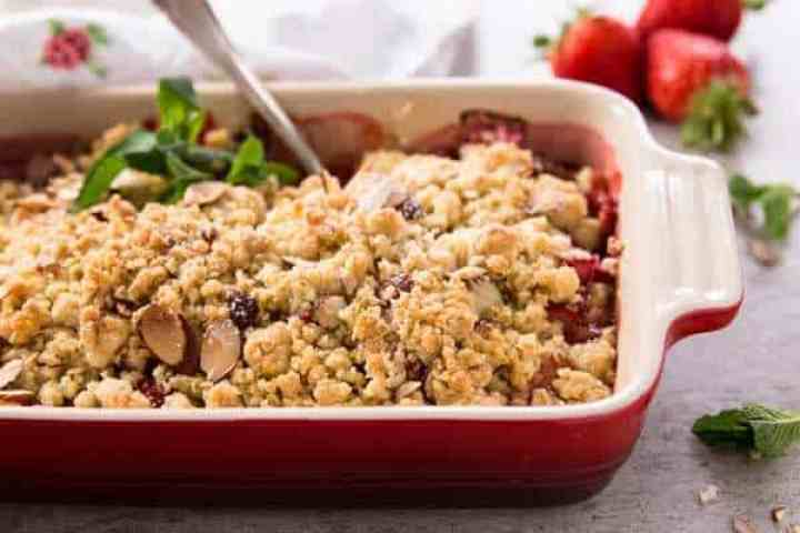 red casserole dish with strawberry rhubarb crisp