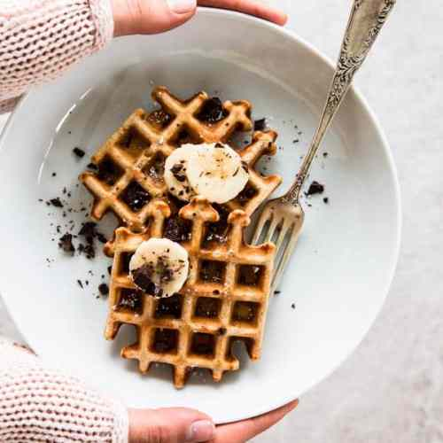 These Healthy Chocolate Chip Banana Waffles are a guilt-free breakfast treat. Dark chocolate chunks male everything so much better!