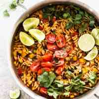 One Pot Black Bean Enchilada Pasta is an easy vegetarian weeknight dinner. Made in just one pot!