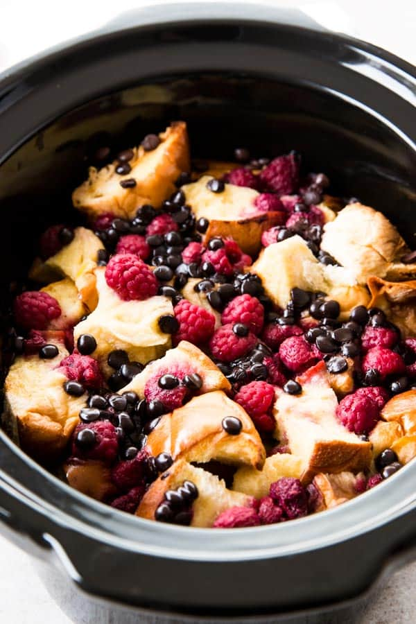 This Crockpot Raspberry Chocolate Chip French Toast Casserole is easy to make and cooks in the slow cooker. Perfect for spring and summer!