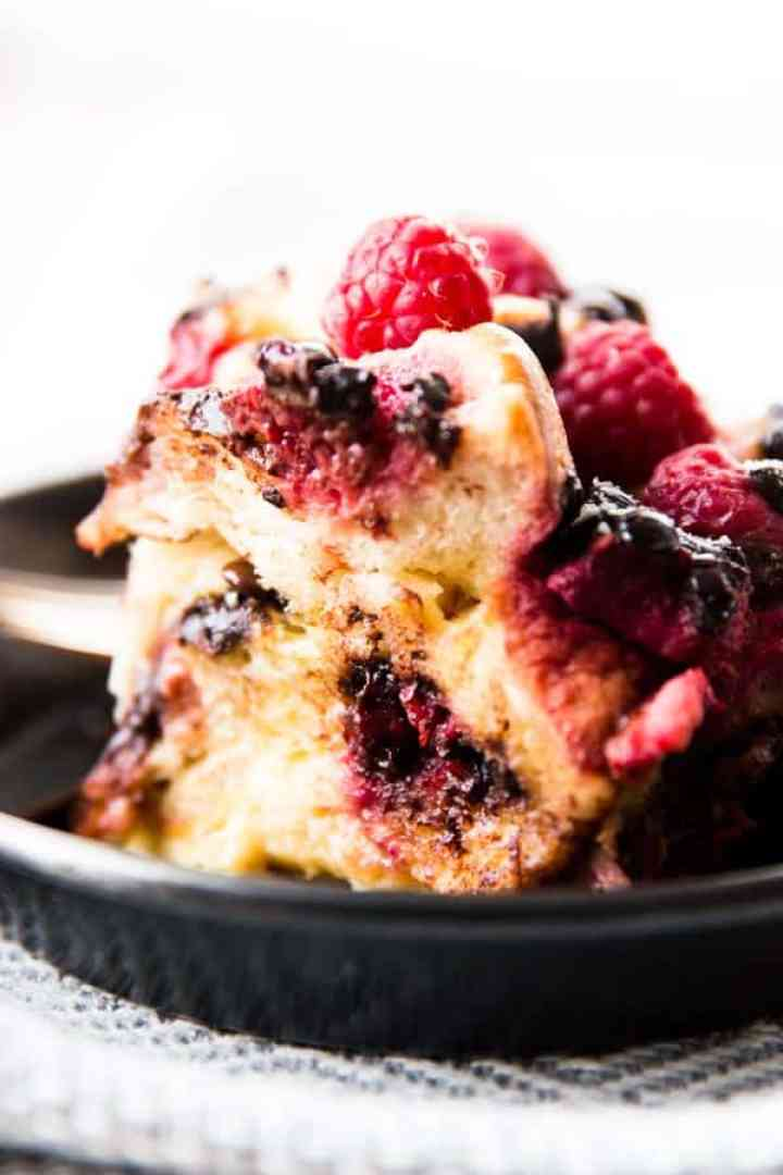 slice of raspberry French toast casserole on black plate