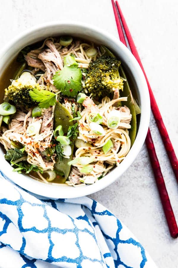 A great slow cooker recipe for summer, these Asian pork noodles are made ENTIRELY in the crockpot! You don't even need to brown the meat, so it heats up your kitchen as little as possible.