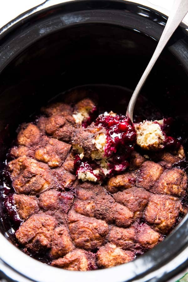 A simple summer dessert, this Slow Cooker Cinnamon Roll Berry Cobbler is guaranteed to be a crowd pleaser. Serve it with ice cream for a special treat!