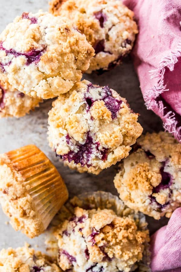 blueberry muffins scattered on light surface