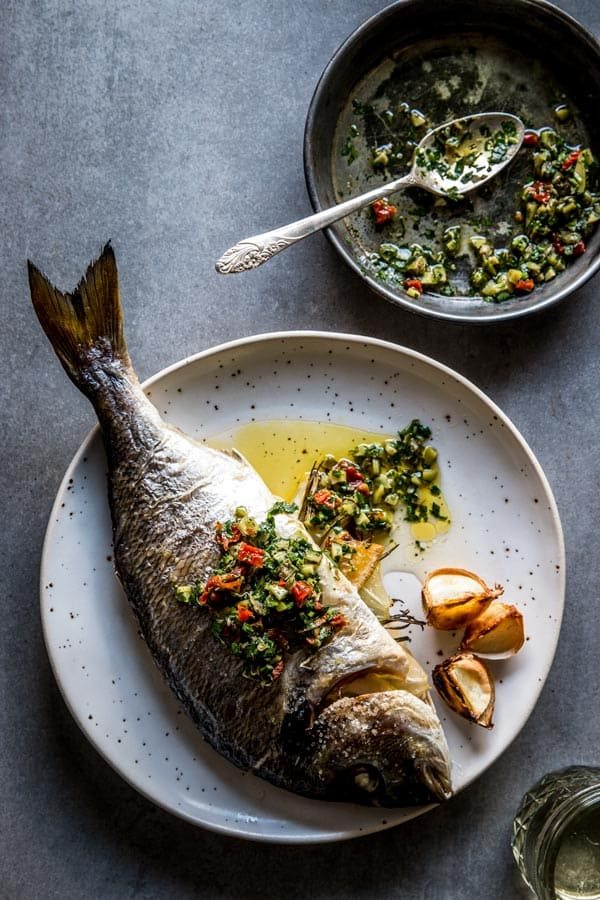 Baked whole fish makes for a delicious and healthy dinner. Everyone loves this easy recipe!