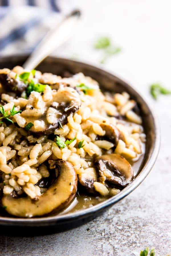 frontal close up of mushroom risotto on a plate