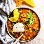 Slow cooker chili in a bowl, ready to be eaten. This is so easy to make and tastes amazing!