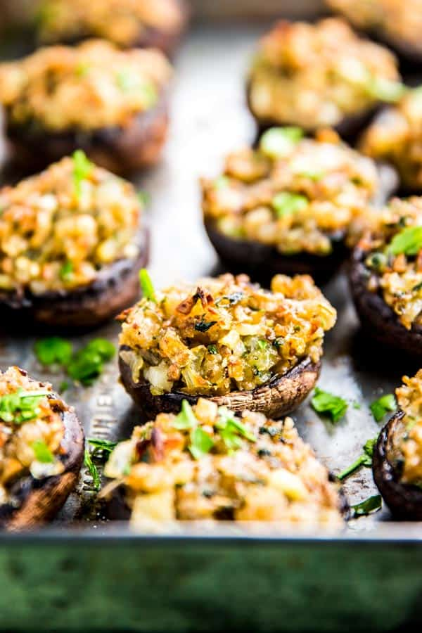 Easy stuffed mushrooms, full of garlic and parmesan flavors! Make them for your next holiday party - they will be gone in no time.