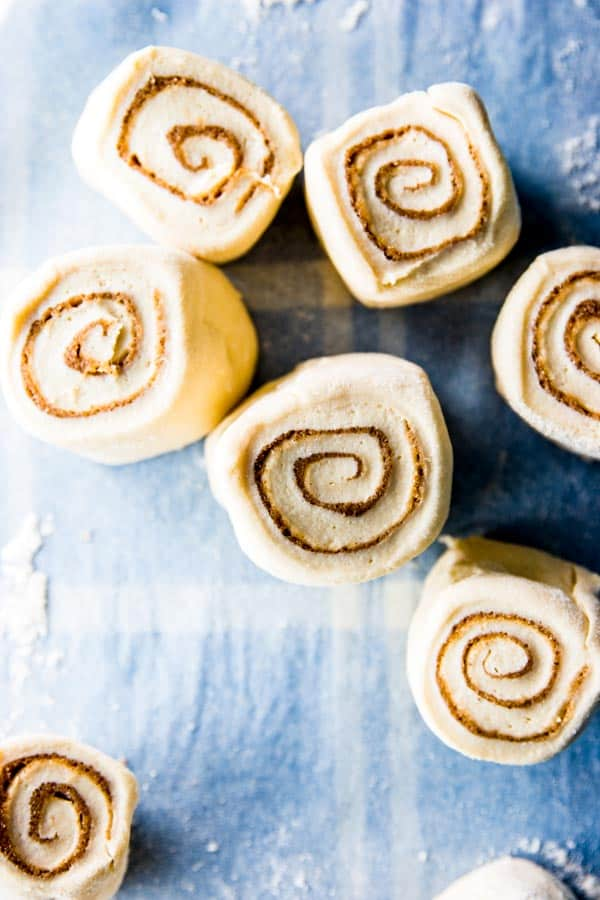 Rolled and cut cinnamon rolls, ready to proof one more time before baking.