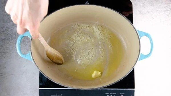 Melting butter in a Dutch oven.
