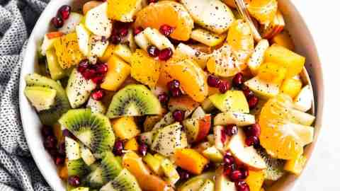 overhead view of bowl with winter fruit salad