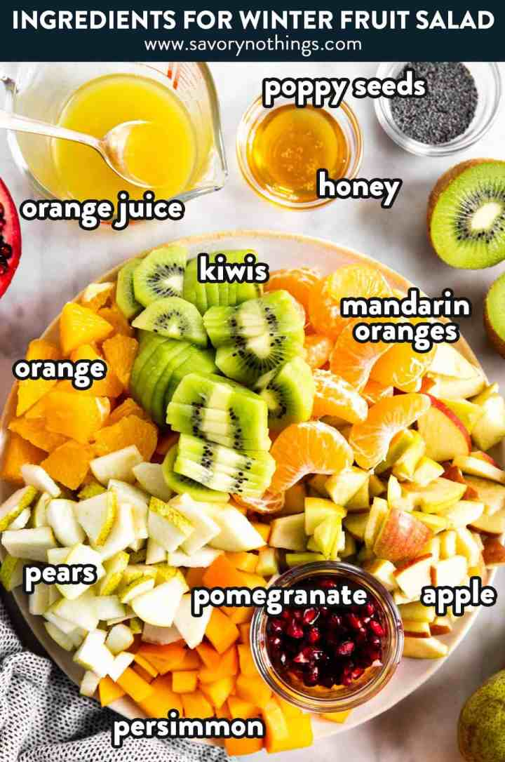 ingredients for winter fruit salad with text labels