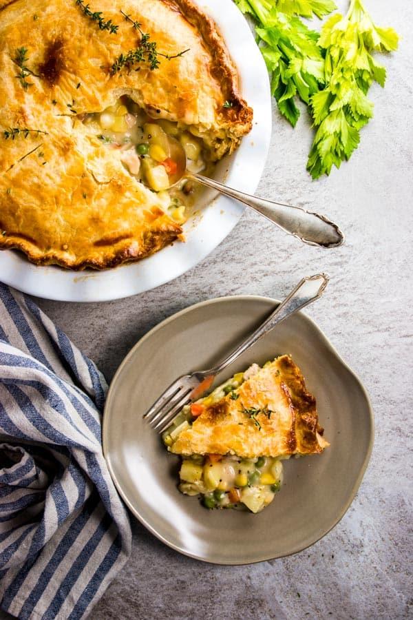 Serving chicken pot pie on a plate.