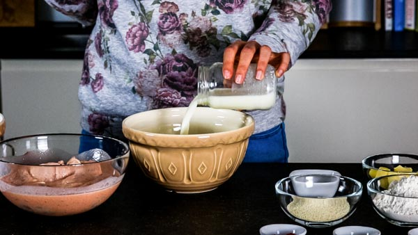How To Make Buttermilk Oven Fried Chicken: Pouring buttermilk into a bowl