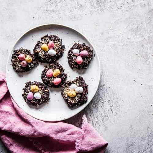 No Bake Bird's Nest Cookies on a countertop on a white plate, next to a pink napkin.