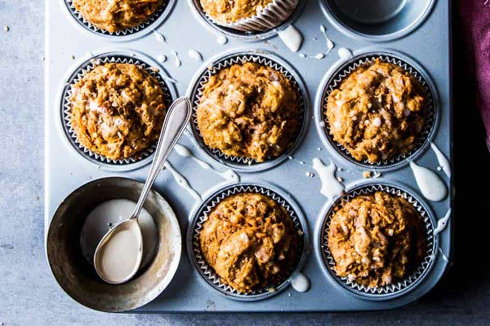 Healthy carrot muffins in a muffin tin.