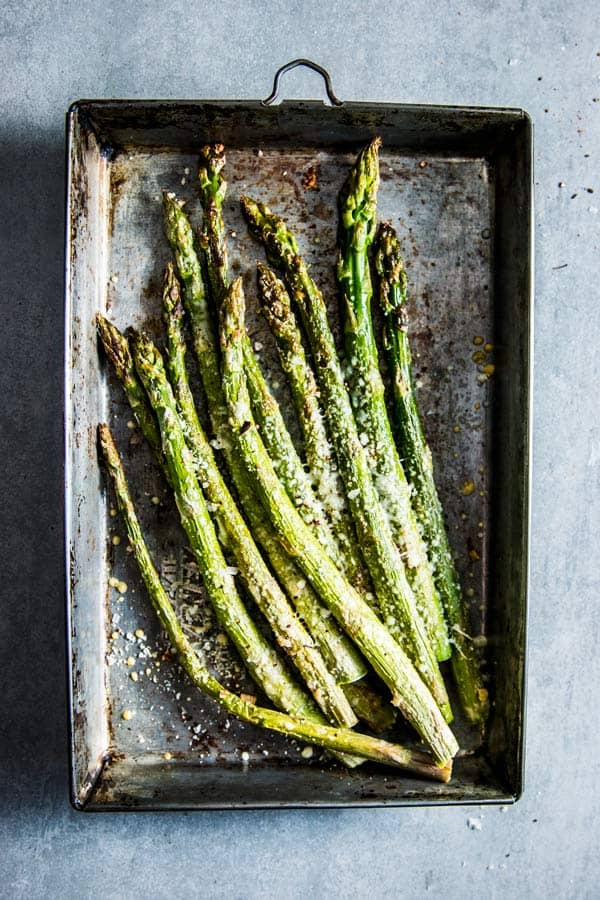 Parmesan Roasted Asparagus on a metal sheet pan.