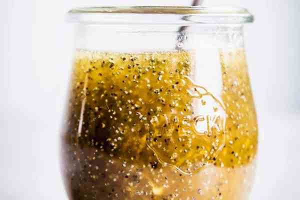 Poppy Seed Fruit Salad Dressing in a weck jar with a silver spoon.