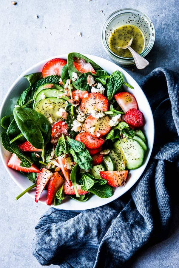 Strawberry Spinach Salad with Poppy Seed Dressing on the side.