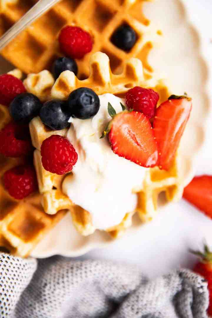 close up photo of waffle with cream and berries