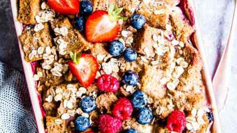 berry French toast bake on the table with fresh berries