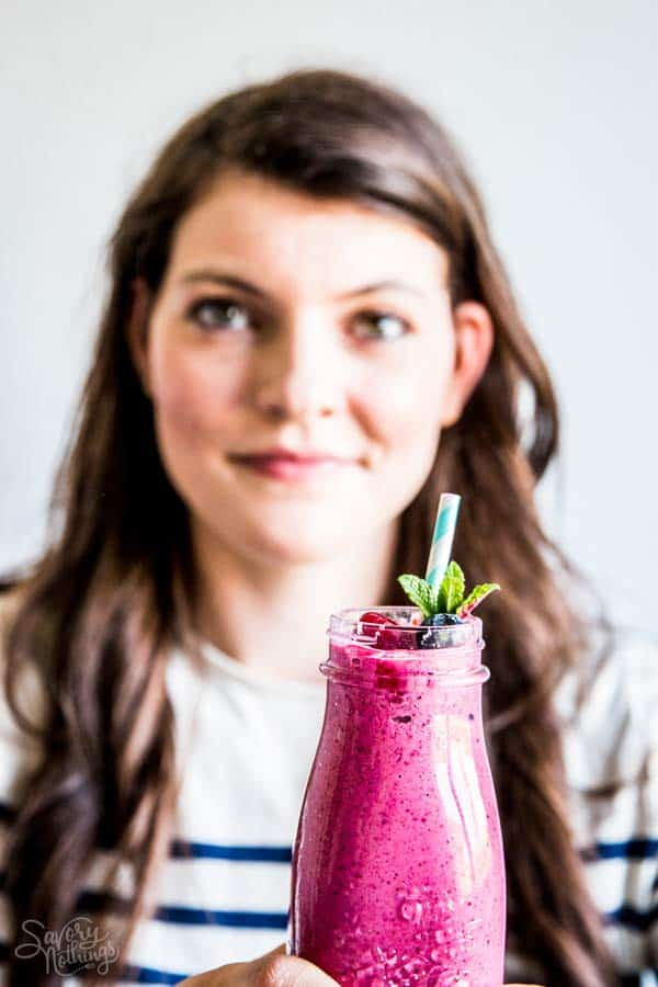 woman with a berry smoothie