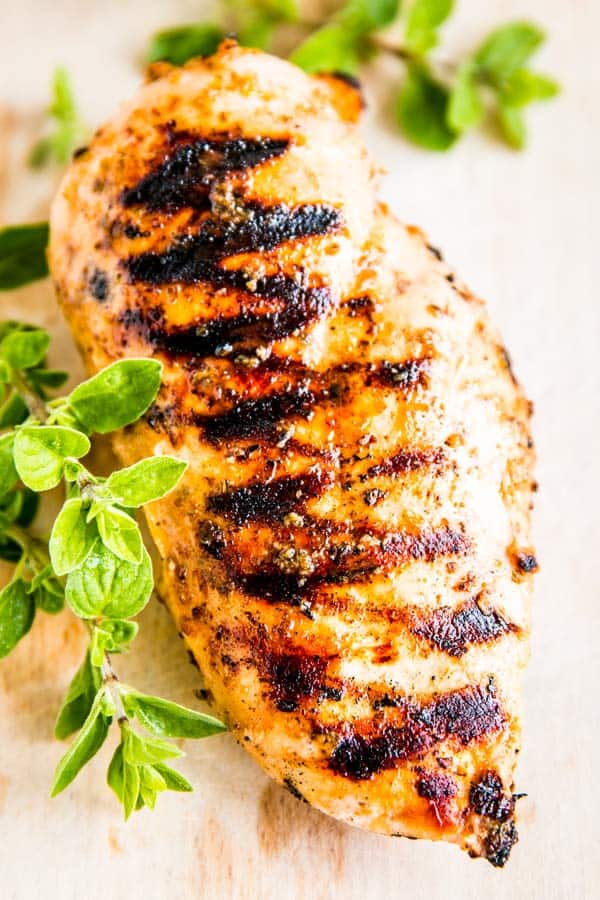 greek chicken marinade on a grilled chicken breast