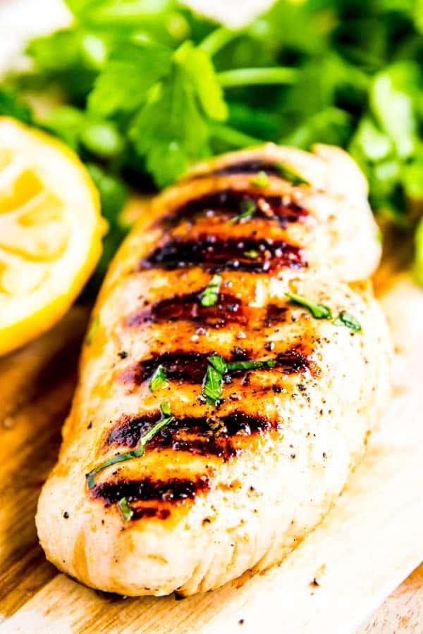 lemon garlic grilled chicken on a wooden board