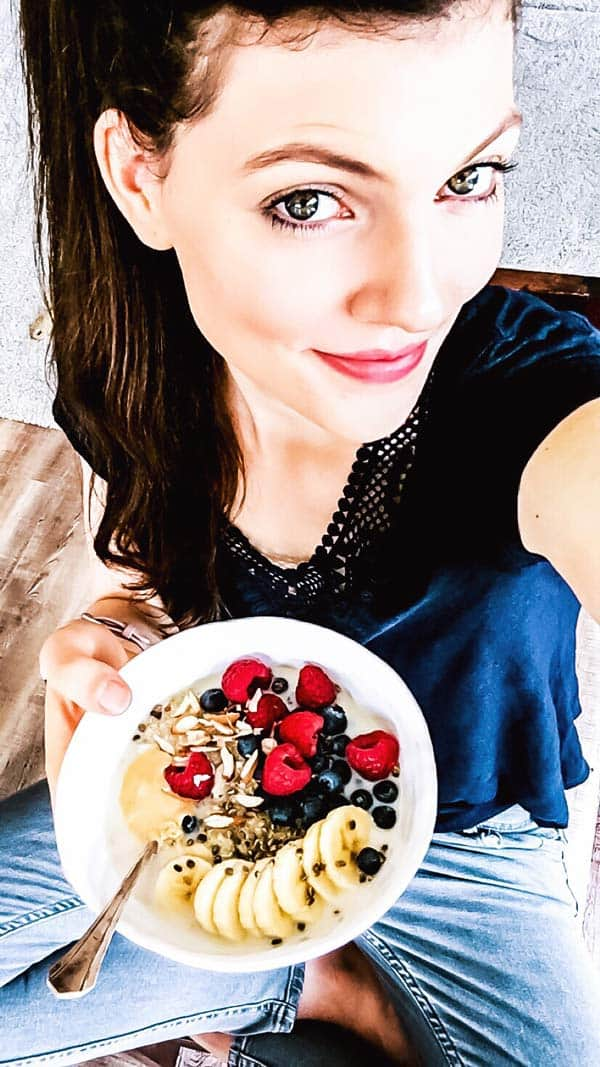 woman with a quinoa breakfast bowl