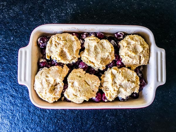 fresh cherry cobbler ready for the oven