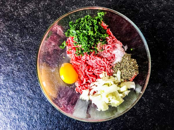 ingredients for meatballs in a bowl