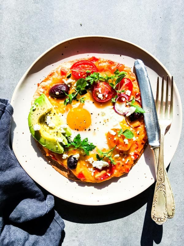 Mexican breakfast pizza on a white plate