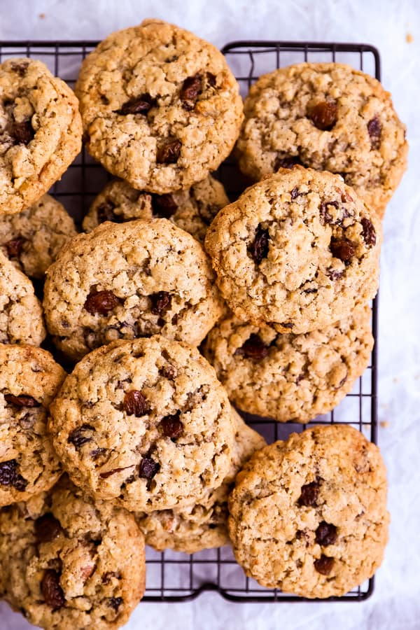 pile of oatmeal raisin cookies on a cooling rack