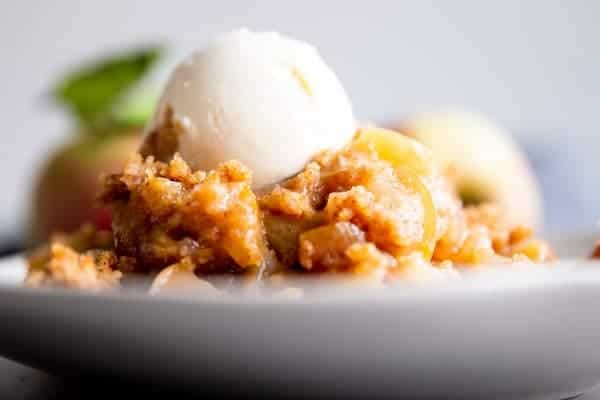 close up photo of apple cobbler on a plate