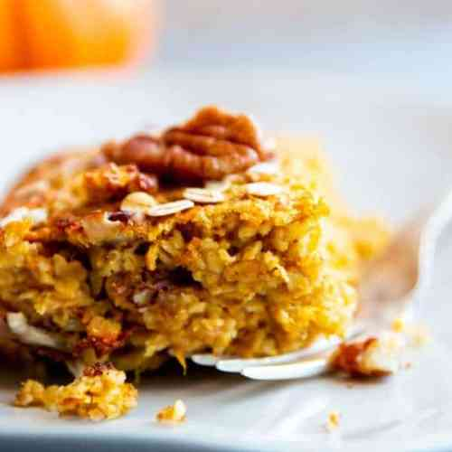 slice of pumpkin baked oatmeal on a white plate