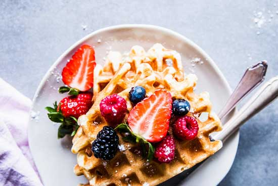 buttermilk waffles on a plate with berries