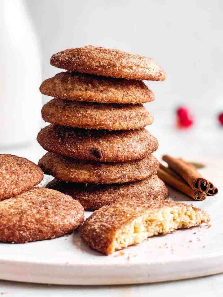 stack of snickerdoodle cookies on a white platter